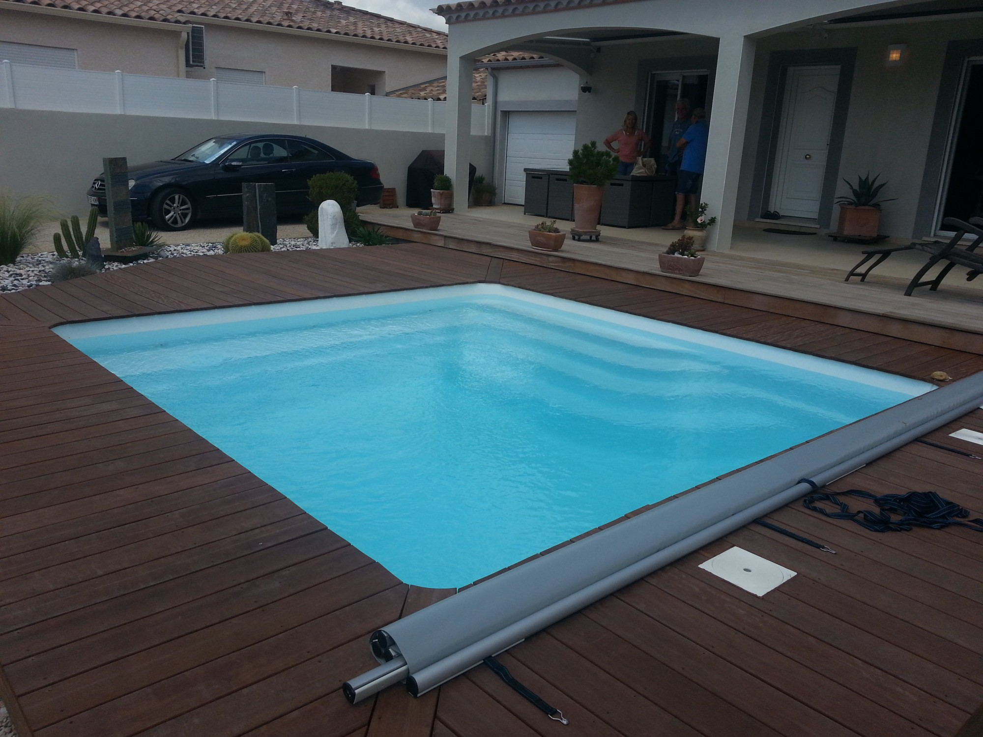 Am nager sa piscine coque polyester piscine polyester for Piscine coque carre